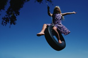 Girl Swinging on Tire